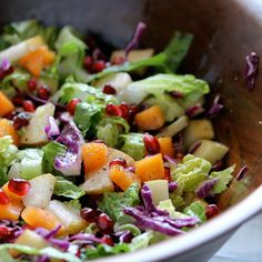 In a large bowl, combine romaine, red cabbage, Fuji apple, Asian pear, Fuju persimmons and pomegranate seeds; toss to mix. In a small bowl, ...