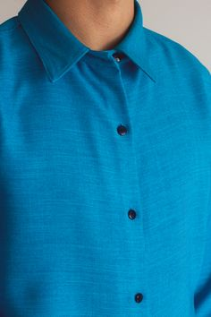 Buttons out in 'Keira' shirt for men.
