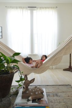 Sun drenched indoor hammock living room inspiration - Indoor hammock hanging ideas ...