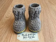 Crochet Baby Cable Boots.  Cozy and adorable these cable knit booties are just right for keeping those precious toes warm this winter. Made of a