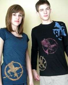 The Hunger Games DIY T-shirts...I need to do this :) and @Jaclynn Koinm would love this!