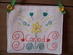 Cariad Bloom Wall hanging (hand embroidered) by Maisy Lee Designs