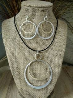 $31.99 Circle Double, Aluminum and Brass.  The brass circle  moves withing the aluminum circle. The Artist Jay, Greensboro, NC