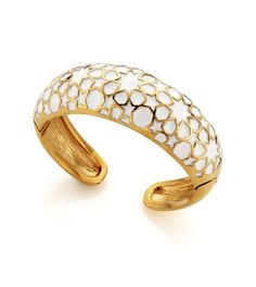 Product details  With its open design the Flip Bangle is a stunning piece created from 316 marine grade stainless steel plated with luxurious 18K gold and titanium.  This bangle fashionably showcases the nature inspired Arabesque pattern highlighted with white enamel.