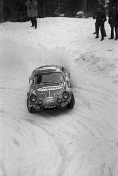 An Alpine Renault engaged in an heavy snowy rally.