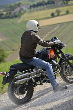 Moto Guzzi V7 Scrambler kit. read all about it: http://motorbikewriter.com/moto-guzzi-v7-becomes-scrambler/