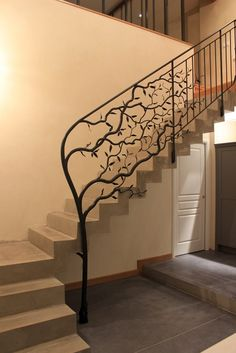 Wrought iron tree sculpture morphs into a traditional looking stair railing. Wrought iron tree sculpture morphs into a traditional looking stair railing. Metal Handrails For Stairs, Iron Handrails, Modern Stair Railing, Wood Handrail, Wrought Iron Stair Railing, Stair Railing Design, Iron Staircase, Staircase Railings, Modern Stairs