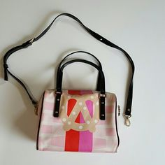 Kate Spade Pretzel purse Adorable Kate Spade New York Darcel Pretzel purse. Wonderful red and pink color strips on a spotted and dotted pink background. On the front is a wonderful soft salted pretzel. Black patent leather straps, hand straps are in perfect condition last picture shows the shoulder strap and the strip that has wear. Inside has signature lining, and some spots from use but nothing major and the outside is just a little dirty. kate spade Bags Shoulder Bags