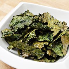KALE CHIPS are incredibly slimming and easy to make: fresh #kale topped with 1 1/2 tsp extra-virgin olive oil, 1/4 tsp salt, and 1/2 tsp lemon zest, baked at 300° for 20 minutes
