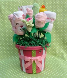 Baby Shower Gift Basket for Newborn Girl, Unique Infant Gift, Baby Clothing Bouquet made from Layette, Onesies, Wash Clothes, Diapers & More via Etsy