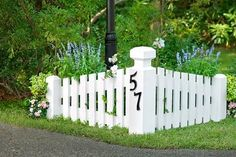 A well-proportioned driveway marker lends a bit of white-picket pizzazz that will help any house stand out among its peers.