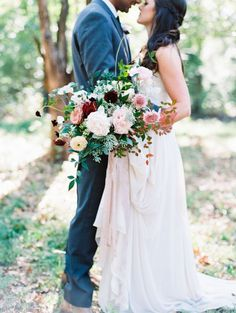 Bold cascading wedding bouquet: Wedding Dress: Truvelle Bridal - http://www.stylemepretty.com/portfolio/truvelle-bridal Floral Design: Pollen Events - http://www.stylemepretty.com/portfolio/pollen-events Bridesmaid dresses: Donna Morgan - http://www.stylemepretty.com/portfolio/donna-morgan-2   Read More on SMP: http://www.stylemepretty.com/2017/02/13/blending-culture-and-tradition-in-the-prettiest-of-ways/