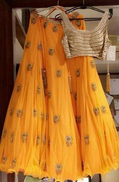 Get yourself dressed up with the latest lehenga designs online. Explore the collection that HappyShappy have. Select your favourite from the wide range of lehenga designs Yellow Lehenga, Red Lehenga, Lehenga Choli, Lehenga Designs, Indian Fashion Trends, Ethnic Fashion, Indian Attire, Indian Ethnic Wear, Indian Dresses