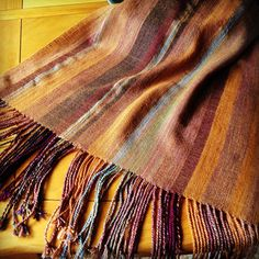 Shawl woven with wool fingering warp and wool lace weight weft.