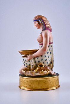 Antique French Egyptian Revival figural porcelain candlestick holder