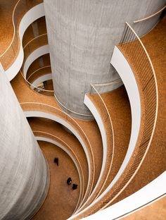 SEB Bank & Pension by Lundgaard and Tranberg  Well-lit work areas surround the cylindrical cores, where stairs, elevators, restrooms and technical shafts are located. #architecture