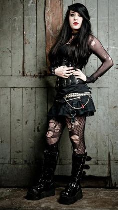 torn fishnet shirt and tights, boots, and skirt  via http://goth-style.tumblr.com/post/38310953073#
