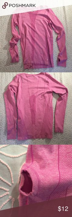 """RBX Runners Athletic Shirt RBX Athletic wear for running or working out. Long sleeved workout shirt. Moisture wicking material. Holes for thumbs. Excellent condition.  Arm pit to arm pit 16"""".  length 24"""" RBX Tops"""