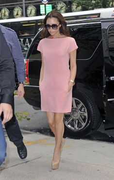 Victoria Beckham Day Dress Victoria Beckham looked sweet as can be preparing for fashion week in a petal pink shift dress. Brand: Victoria Beckham