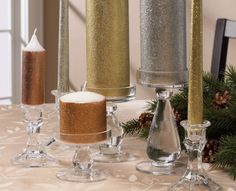 Silver and gold make a festive holiday home. These two colors can add wonders to your home this time of year. If you would like add some sparkle to your holiday decor, create these Martha Stewart Holiday Candles. Martha Stewart makes some of the most beautiful craft project for the holidays, and these are no exception. #PlaidCrafts