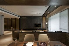 Stone and Wood Make a Dark, Masculine Interior. dark-wood-dining-table