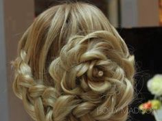 This is a gorgeous hairstyle for weddings. This would go great with a ballgown!