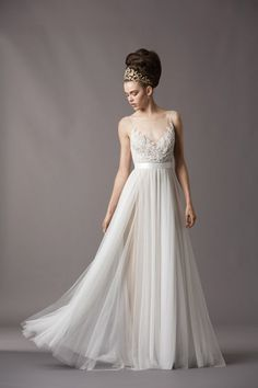 Take his breath away in this soft and pretty Watters gown (Style 4061B) featuring a bateau illusion neckline with pearl buttons and loops.