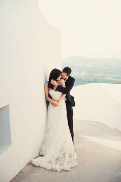bride and groom in santorini greece http://trendybride.net/destination-greece-wedding-from-anna-roussos-photography/ #trendybride