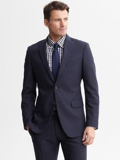 Navy is a great first suit color. If cut correctly, it will last for years.