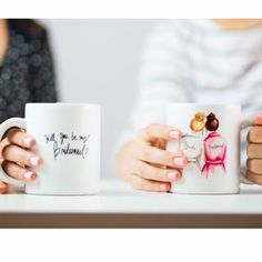 """Ask your friends and family to stand beside you with a functional keepsake! On this mug, a Brunette Bun Bride is featured with her Brunette Bridesmaid (bun). The back reads, """"Will You Be My Bridesmaid?"""" I'm so excited to now be offering my very popular """"Will you be my Bridesmaid?"""" design on mugs! Fill it with chocoloate-y goodness or yummy gourmet coffee to make her feel as special as she is. These white, glossy ceramic mugs are available in 11oz. Dishwasher and microwave safe. Don't see…"""