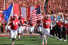 UW players enter the game on Homecoming vs. Maryland Oct. 25, 2014.