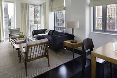 THIS JUST INN | The Thompson Suite, with comfortable yet modern interiors and floor to ceiling windows showcasing historical Tribeca.