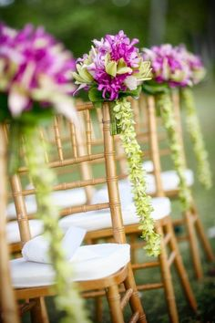like the orchid garland hanging from bouquet - maybe hang from cheapy carnation poms?
