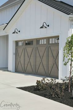 Transform and update the exterior of your home instantly by replacing doors with a more modern garage door design. We're showing you garage door styles to consider and what you need to think about when choosing modern garage door designs. Farmhouse Landscaping, Modern Farmhouse Exterior, Farmhouse Interior, Farmhouse Design, Farmhouse Style, Farmhouse Door, Cottage Exterior, Farmhouse Remodel, English Farmhouse