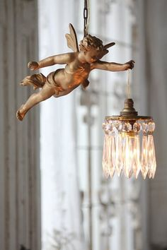 I love this lighting...cherub holding a chandelier:brilliant