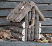 The log cabin bird house is made with Italian Cypress and is the perfect nesting place for birds in your yard.