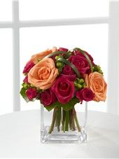The Deep Emotions Bouquet is a bright and cheery bouquet of orange roses, hot pink roses and green hypericum accents in a clear block vase. Hot Pink Roses, Orange Roses, Same Day Flower Delivery, Clear Glass Vases, Flowers Delivered, Spray Roses, Rose Bouquet, New Baby Products, Bloom