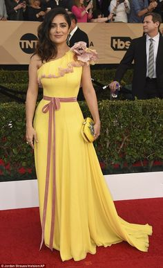 Eye-catching: Salma Hayek made a rare fashion faux pas Sunday as she arrived at the SAG Awards in Los Angeles in a bright buttercup yellow gown with dusky pink detailing
