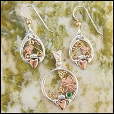 Unique Claddagh pendant and earring set in Sterling Silver, with 14K Gold accents, set with a Tsavorite Garnet.