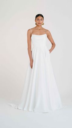 Meet Jenny Yoo's Thalia gown for Fall 2020. Let out your inner socialite in the Thalia, who's soft Mikado and ballgown skirt were made forwaltzing around the dance floor. Featuring a scoop neckline, Open back long Chapel train skirt. This stunning & chic wedding dress is perfect for a Spring, Fall or Winter wedding! Chic Wedding Dresses, Most Beautiful Wedding Dresses, Gowns With Sleeves, Chapel Train, Thalia, One Shoulder Wedding Dress, Ball Gowns, Neckline, Collections