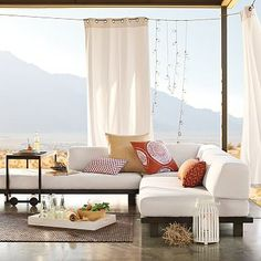 We need some outdoor curtains like this, so we aren't staring into the sunlight of our neighbour's bathroom.