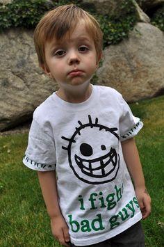 I Am Momma - Hear Me Roar: Shy boy wearing i fight bad guys t-shirt.