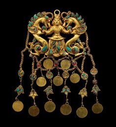"""One of a pair of #gold pendants with turquoise, garnet, lapis lazuli, carnelian and pearls showing the """"Dragon Master,"""" from the second quarter of the first century A.D., found at #Tillya_Tepe in northern #Afghanistan. #nomad #scythian"""