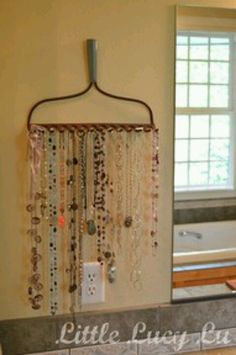 Rake necklace display::just finished one :) so happy I had one laying in the yard!
