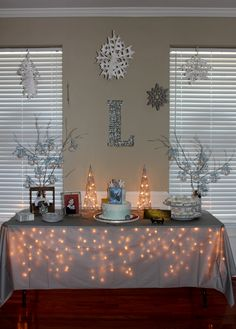 Polar Express Birthday Party - Cake Table Love the icicle lights under the table cloth.                                                                                                                                                                                 More