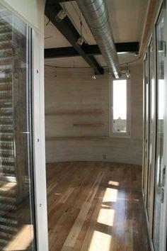 Inside of a grain silo made into an apartment.
