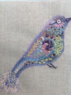No instructions but I think it would work to begin with a bird cut from felt and then embroider it heavily.