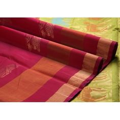 Lustrous maroon in the body with a contrast lemon green border! The deer motif in the intricately woven pallu makes it very interesting!