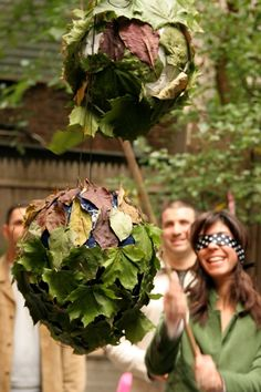 leafy pinata from a balloon, newspaper, and leaves! This could work with so many themes - outdoor, fairy/fairytale, forest/woods...the list goes on