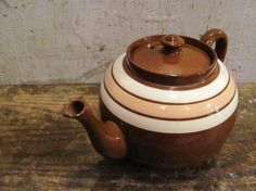 """""""Secret of Roan Inish"""" teapot.(We had one like this growing up .It held 8 cups and had a stripe of sage green. It was on the table every night with supper filled with black tea)"""